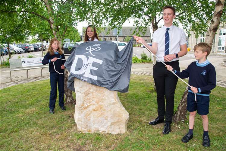 Rose MacPherson-Grant, Catriona Sutherland, Blair Jackson and Finn Barber...A plaque is unveiled at Moray Council's HQ in Elgin, to help tell the story of the Duke of Edinburgh Awards and its Moray roots